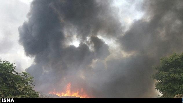 آتش سوزی در جنگل های انباشته از زباله چالوس+تصاویر/ آتش مهار شد